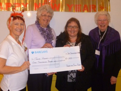 Take Heart - Lita Freegard hands cheque