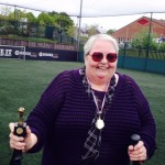 Annie the chair of Southend Puffers Club with the smallest Trophy in the world!